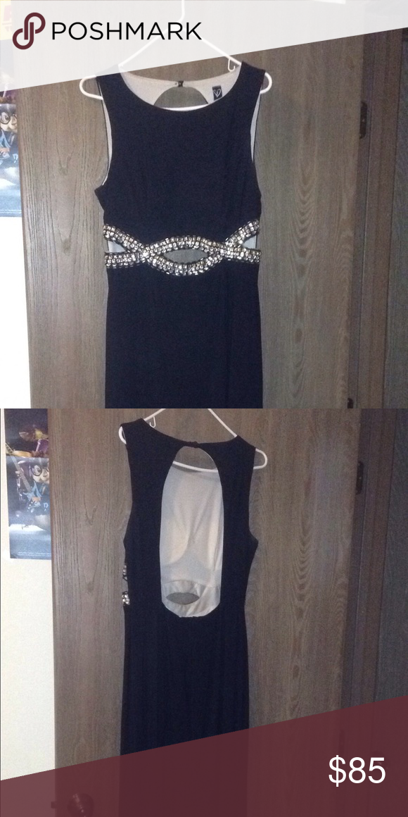 Homecoming\prom dress I bought this dress for my HighSchool prom in April of last year. Only worn once and like new. Size 13/14. Form fitting. WINDSOR Dresses Prom