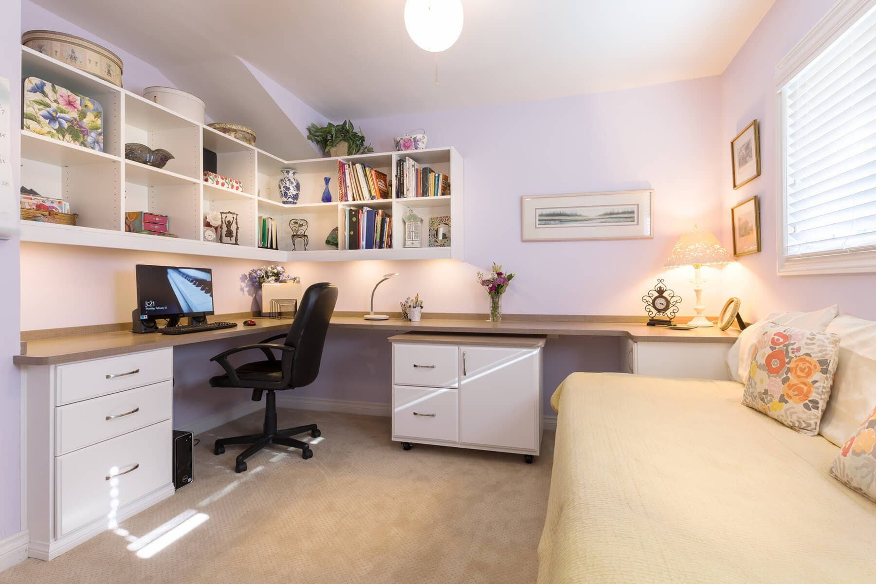 White melamine home office incorporates plenty of overhead book shelving and a movable drawer/cabinet unit.