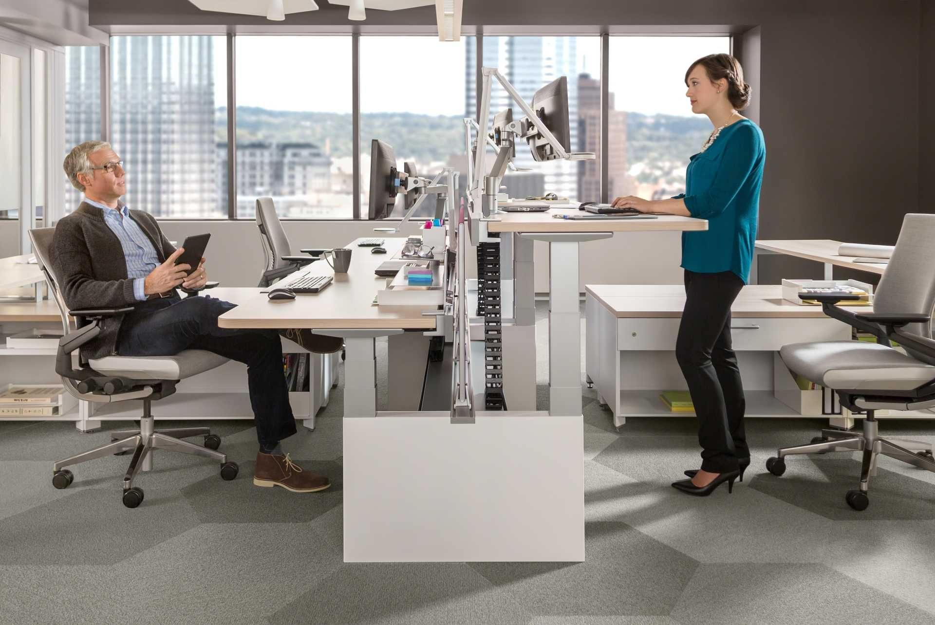 Here you can see a mix of Sitting Standing Desks but at a