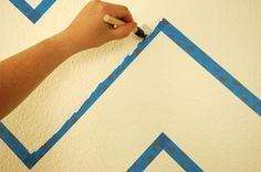 Super clever technique for getting perfectly straight edges when painting stripes on textured walls