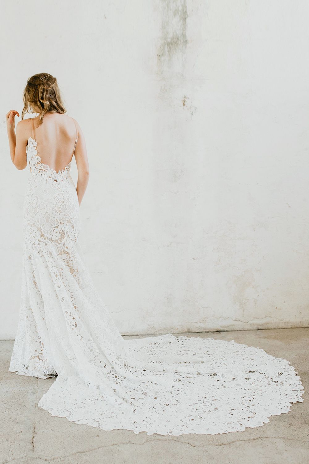 Lace wedding gown with plunging open back and long train celeste by