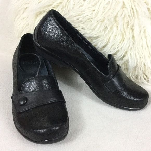 Dansko black leather comfort shoes Dansko beautiful black pebbled style leather comfort shoes. Black strap and button across front adds a nice detail. Gently loved and in wonderful condition just a little sticker residue on insoles   States size 38 on soles. They measure just under 10' long   A stylish shoe to be able to stand long hours in.  416-68 Dansko Shoes Flats & Loafers