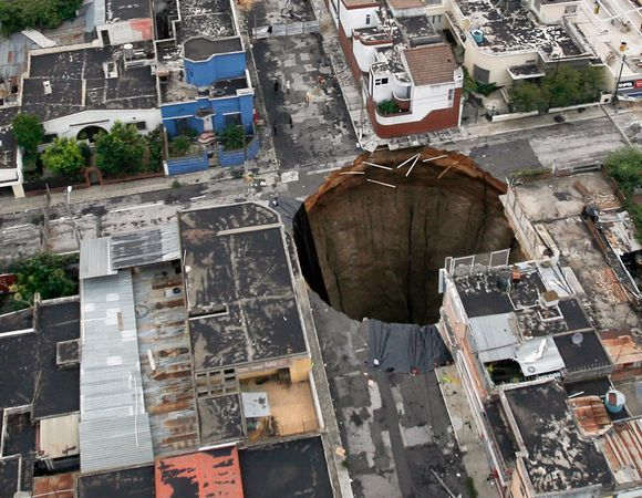 Guatemala Sinkhole Created By Humans Not Nature The Earth Guatemala City Wonders Of The World Planet Earth