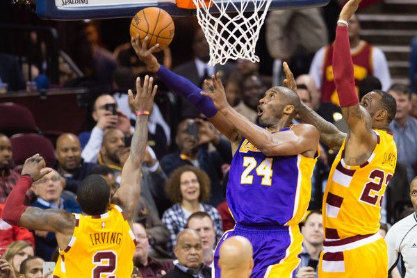 245197751d0 Kyrie Irving  2 and LeBron James  23 of the Cleveland Cavaliers try to stop  Kobe Bryant  24 of the Los Angeles Lakers during the second half at Quicken  ...