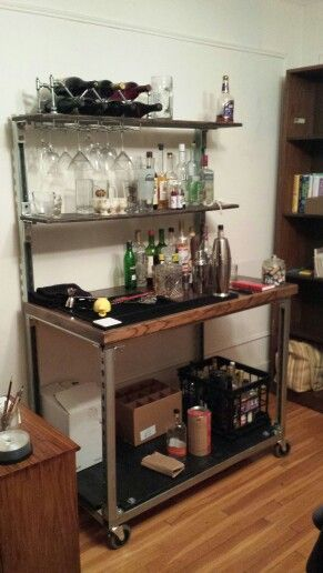 my finished bar made out of recycled wood and unistrut