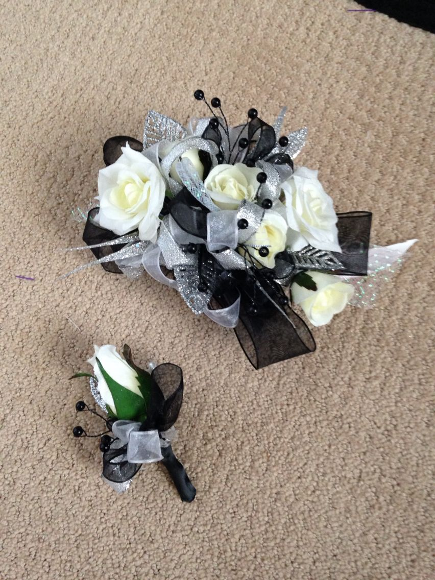 Black white and silver prom corsage id personally like it better if hen house designs full service silk florist in denham springs la can assist you with wedding flowers or any occasion or event mightylinksfo Choice Image