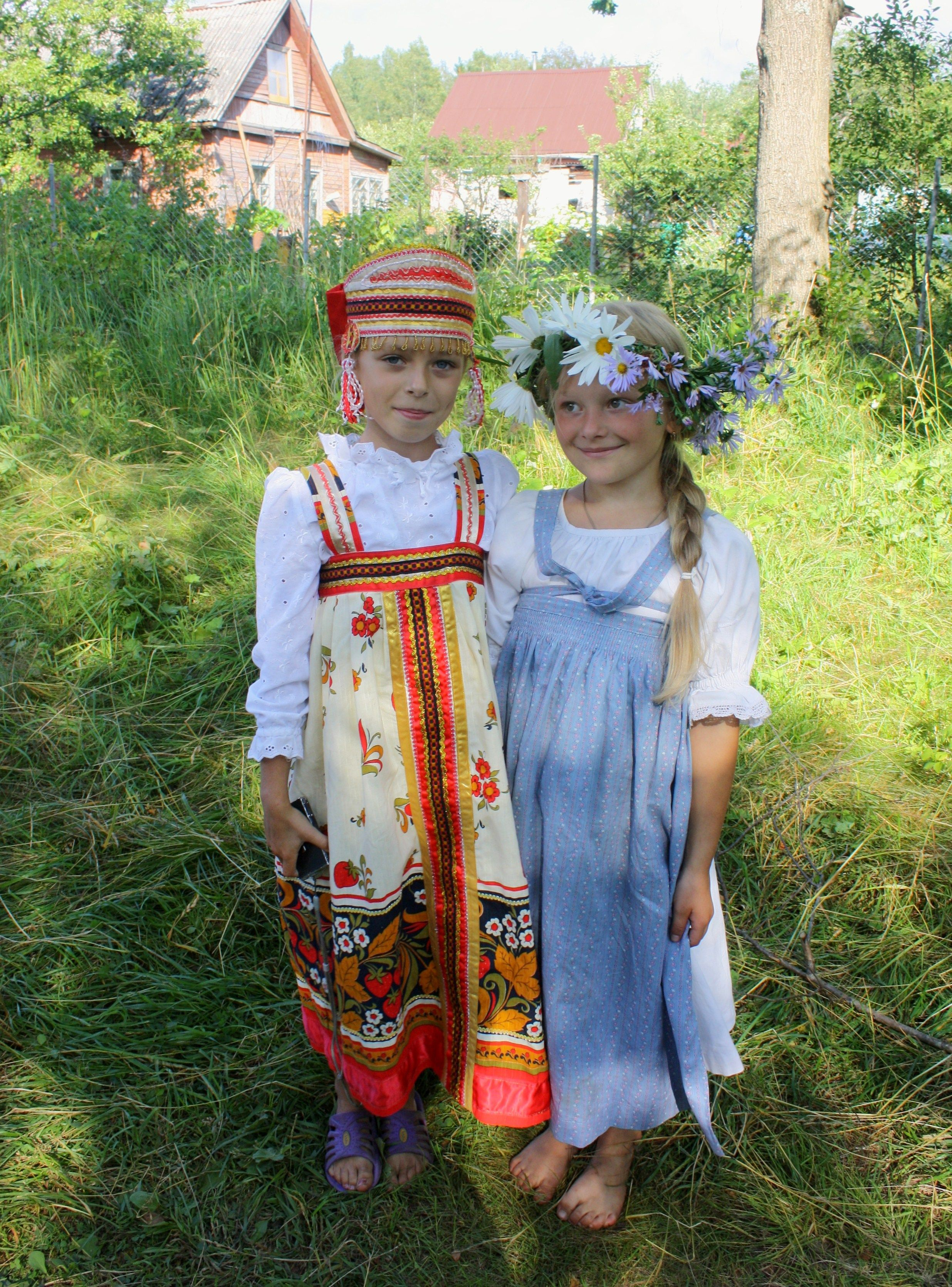 two pretty girls in russian traditional costumes