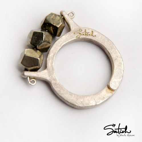 https://www.cityblis.com/7451/item/6151  3 Pyrite Ring - $75 by Satish by Roula Dfouni  Easy to wear ring with semi-precious Pyrite that gives it its shimmering and artistic texture. Adjustable ring from size 5-9 , width of the ring 3mm, width and height of Pyrite 5mm each.