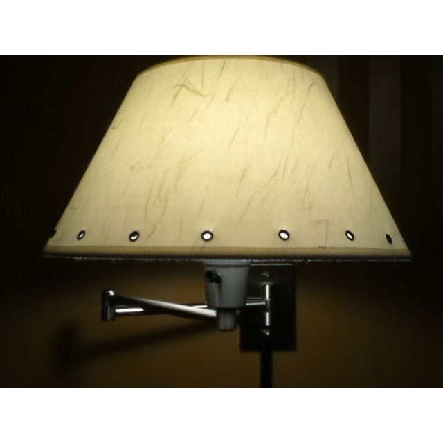 I added grommets to our bedroom lamp shades the same color as the walls.