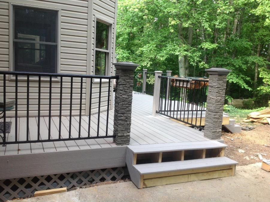 New Composite deck using Lowe's ChoiceDek and faux stone