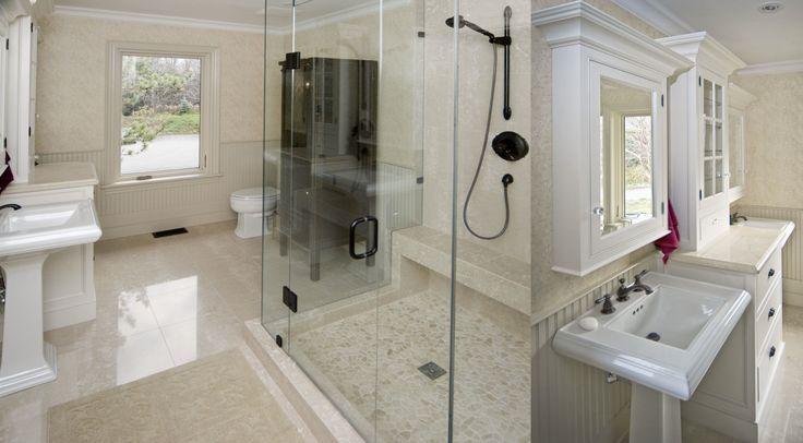 Beautiful custom bathroom by Ferguson Fine Homes. Stone and pebble tile floors, furniture style cabinetry. www.fergusonfinehomes.com