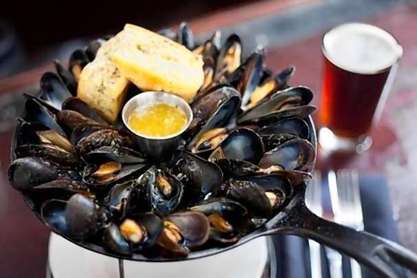 Yield: 4 to 6 servings3 ounces kosher sea salt3 ounces extra-virgin olive oil1 pound Prince Edward Island blue mussels, cleaned, debearded and dried2 ounces warm melted butter1 loaf ciabatta bread,...