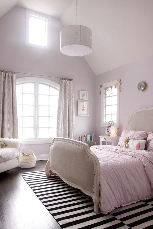 Light Pink Girlu0027s Bedroom Features A Light Pink Walls Framing A Curved  Window Dressed In Light