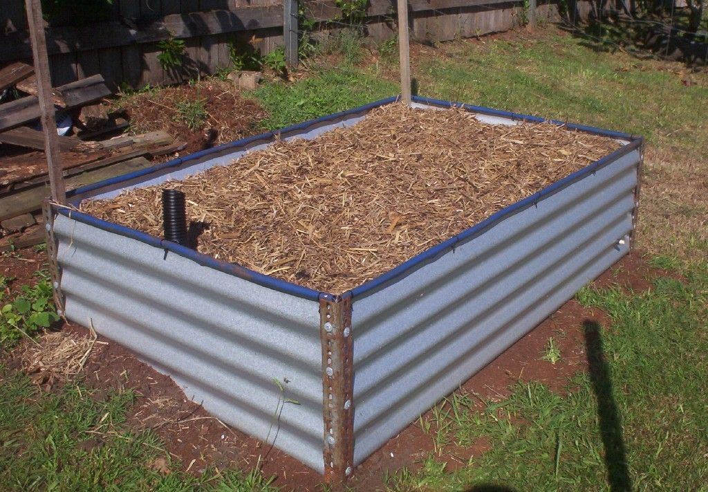 Elevated Garden Ideas 3 corrugated metal and wood beds Raised Garden Bed Ideas Garden Ideas Picture
