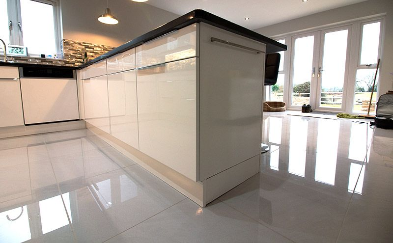 High Shine Flooring In This Kitchen Diner Of A New Build Property High Gloss Flooring Luxury Bathroom Tiles Luxury Bathroom Flooring