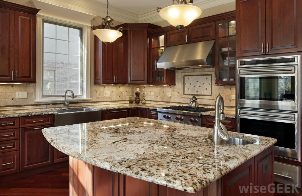 Kitchen Cabinets Cherry Wood painted oak cabinets to look like cherry | pendant lighting is