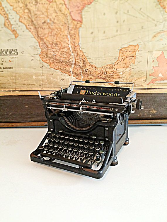 Classic black antique underwood 11 typewriter by FlickerAndSway