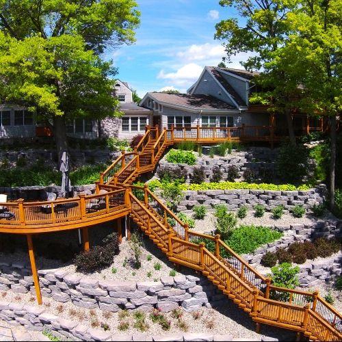Custom Cedar Stairs With A Radius Rail And Aluminum