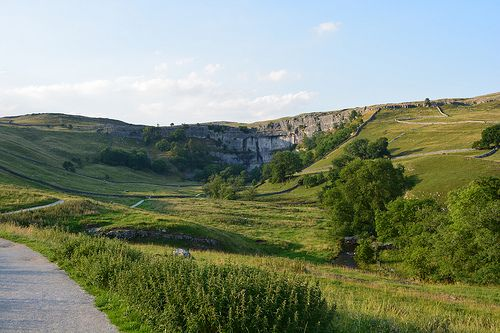 Malham Cove is a natural limestone formation 1 km north of the village of Malham, North Yorkshire, England