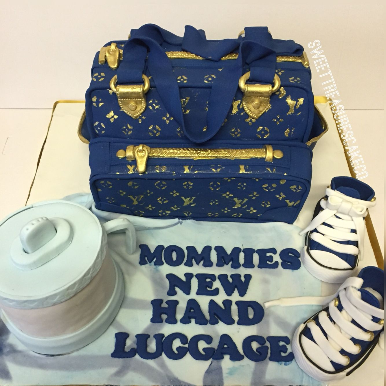 6e3f2d7165b7 Louis Vuitton baby diaper bag baby shower cake. Blue and gold.