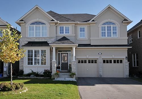Taupe exterior white trim grey roof house exterior for Exterior stucco trim ideas