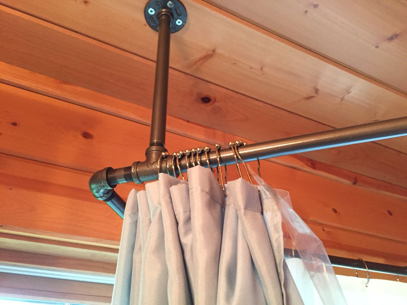 Used Black Iron Piping To Create A Shower Curtain Rod That