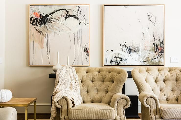 Beautiful Living Room Features A Pair Of Cream Tufted Accent