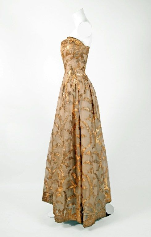 1950's Elizabeth Arden couture metallic-gold silk lame strapless evening gown...side view.