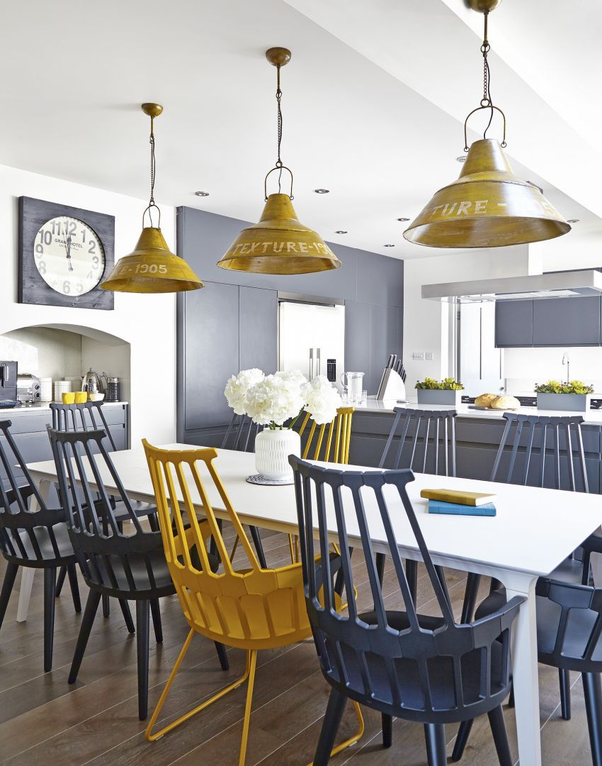 Modern kitchen with yellow and grey accessories dining for Grey yellow kitchen ideas