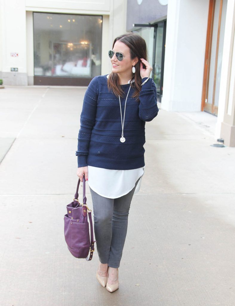 5faef22165a Houston Fashion Blogger styles a winter layered outfit featuring a navy  sweater