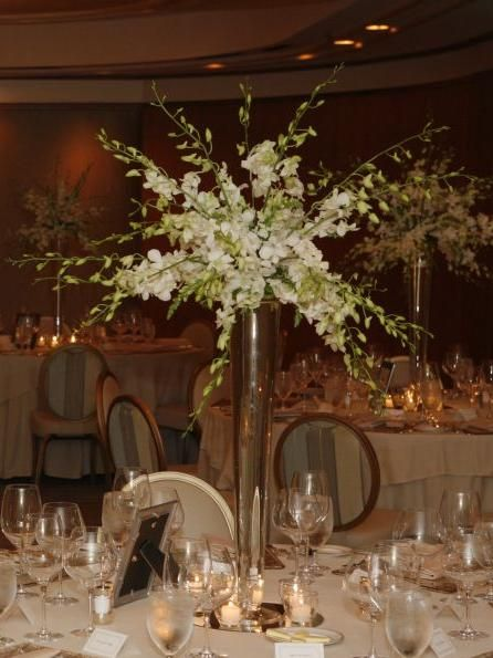 White dendrobium orchids centerpieces wedding