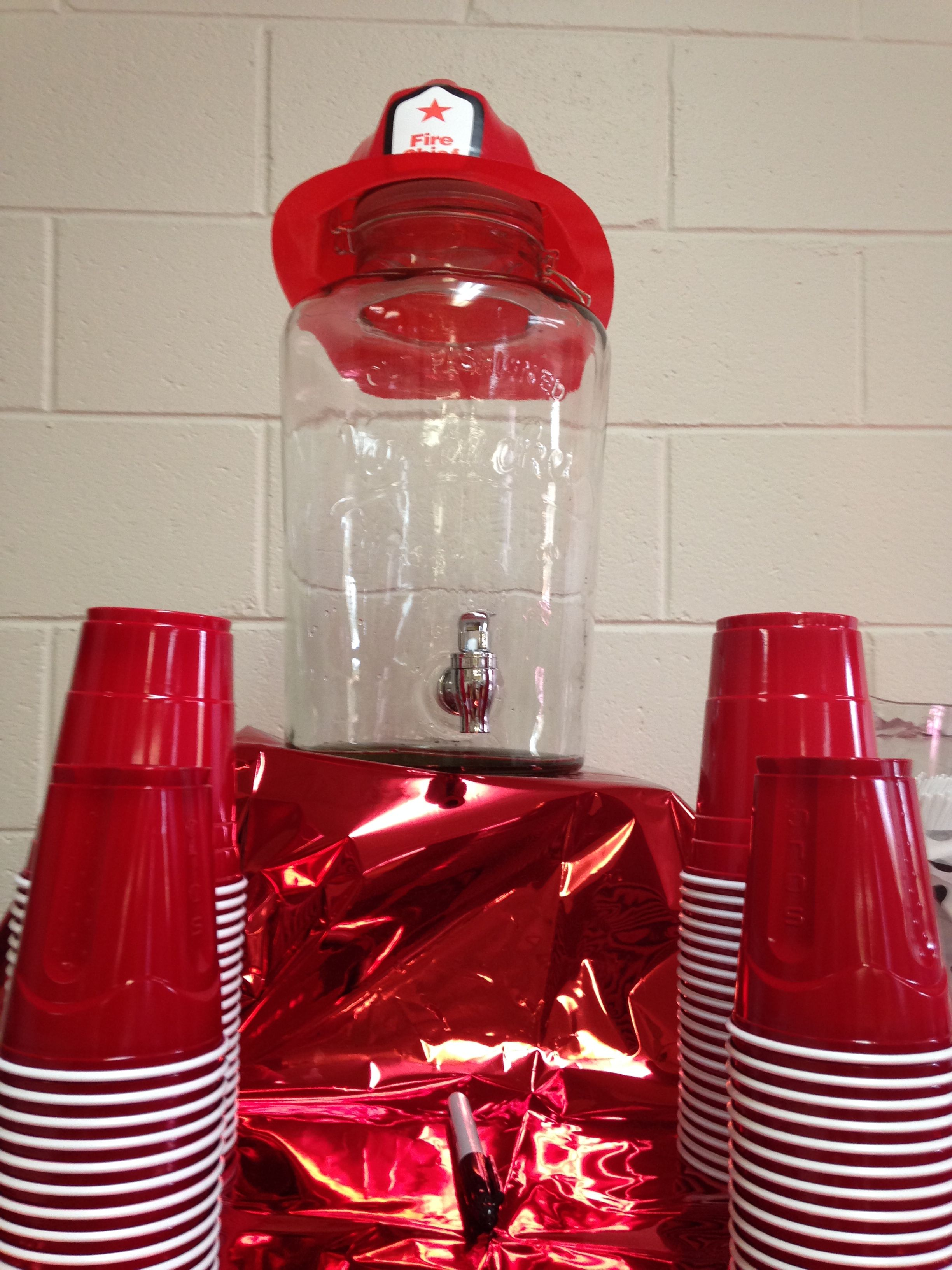 Fireman party drink dispenser covered with for what and