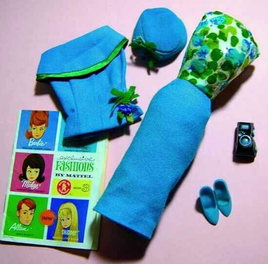 There are 2 different ensembles here...*Vintage Barbie Fashion Editor #1635 (1965)Turquoise Dress with Floral BodiceTurquoise Sleeveless JacketTurquoise Pillbox HatTurquoise Closed Toe HeelsBlack Plastic Camera. *Vintage Barbie Club Meeting #1672 (1966-1967) Turquoise Dress with Floral BodiceTurquoise Sleeveless JacketTurquoise Closed Toe HeelsThese two vintage ensembles are the same, with the hat and camera removed from the renamed version in 1966.The dress has a floral silk bodice with…