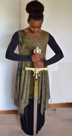 Army Green Glitter Dance Top  Starting at: $45.00 This garment is perfect for any dance or performance that call for a warfare look. It is all glitter with a lined blouse and hankie hem skirt.