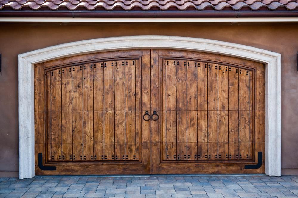 11 Carriage Doors That Will Give Any Home An Old World Charm Garage Door Design Wooden Garage Doors Garage Doors