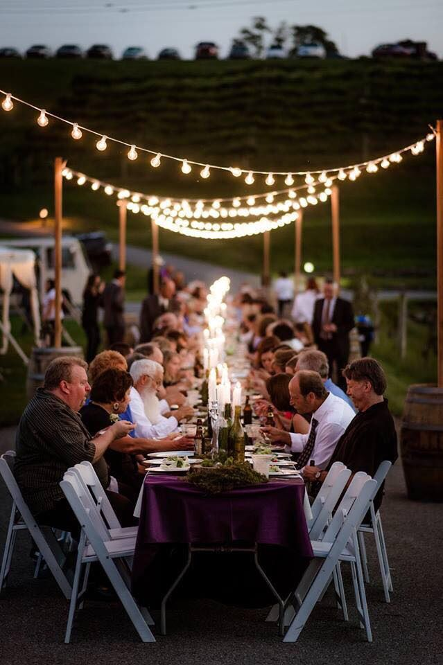 Outdoor cafe lighting draped over a 200 long dinner table outdoor cafe lighting draped over a 200 long dinner table lighting support poles aloadofball Gallery