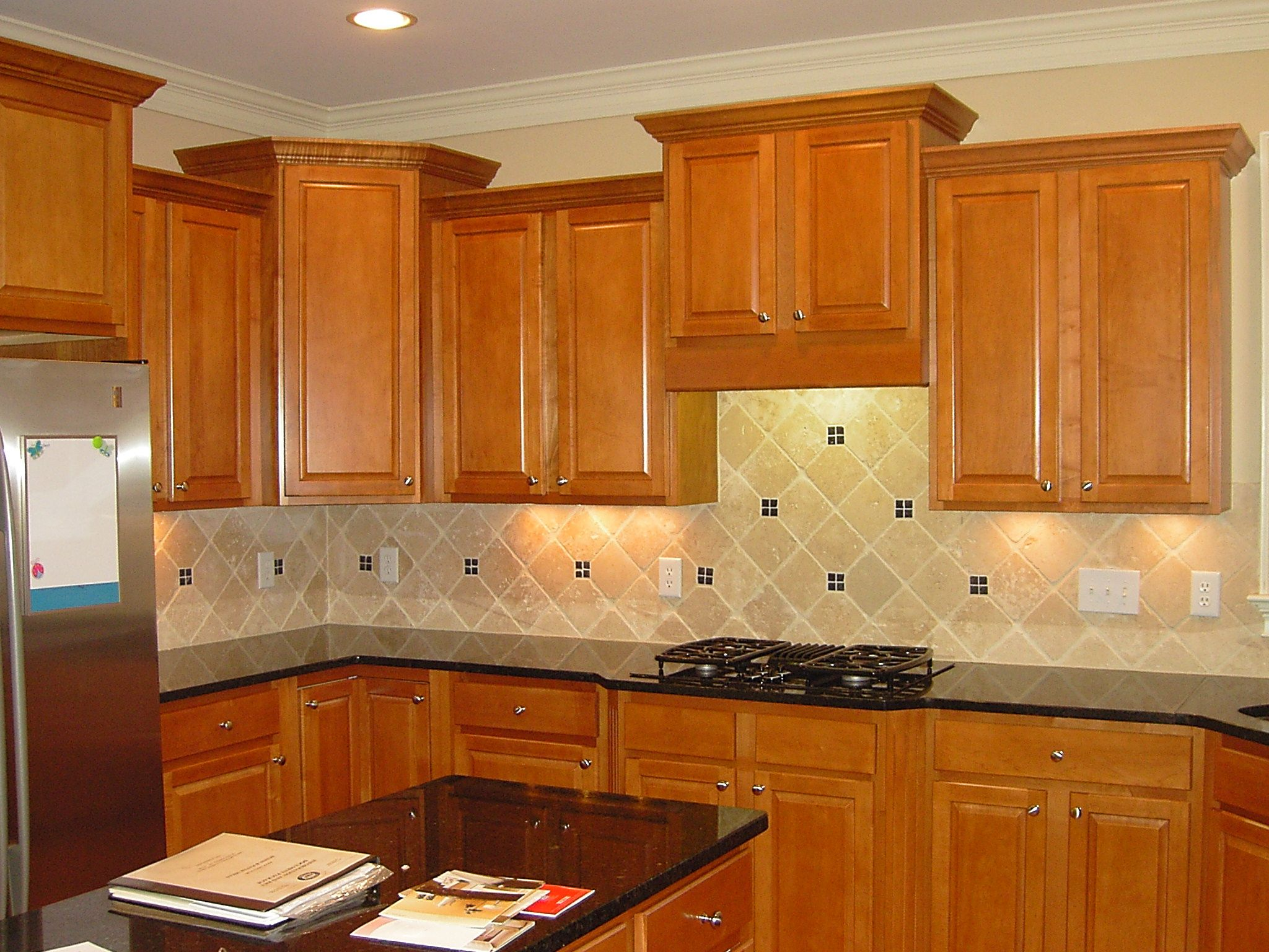 backsplash with dark countertops backsplash with natural brown painted cabinets also black