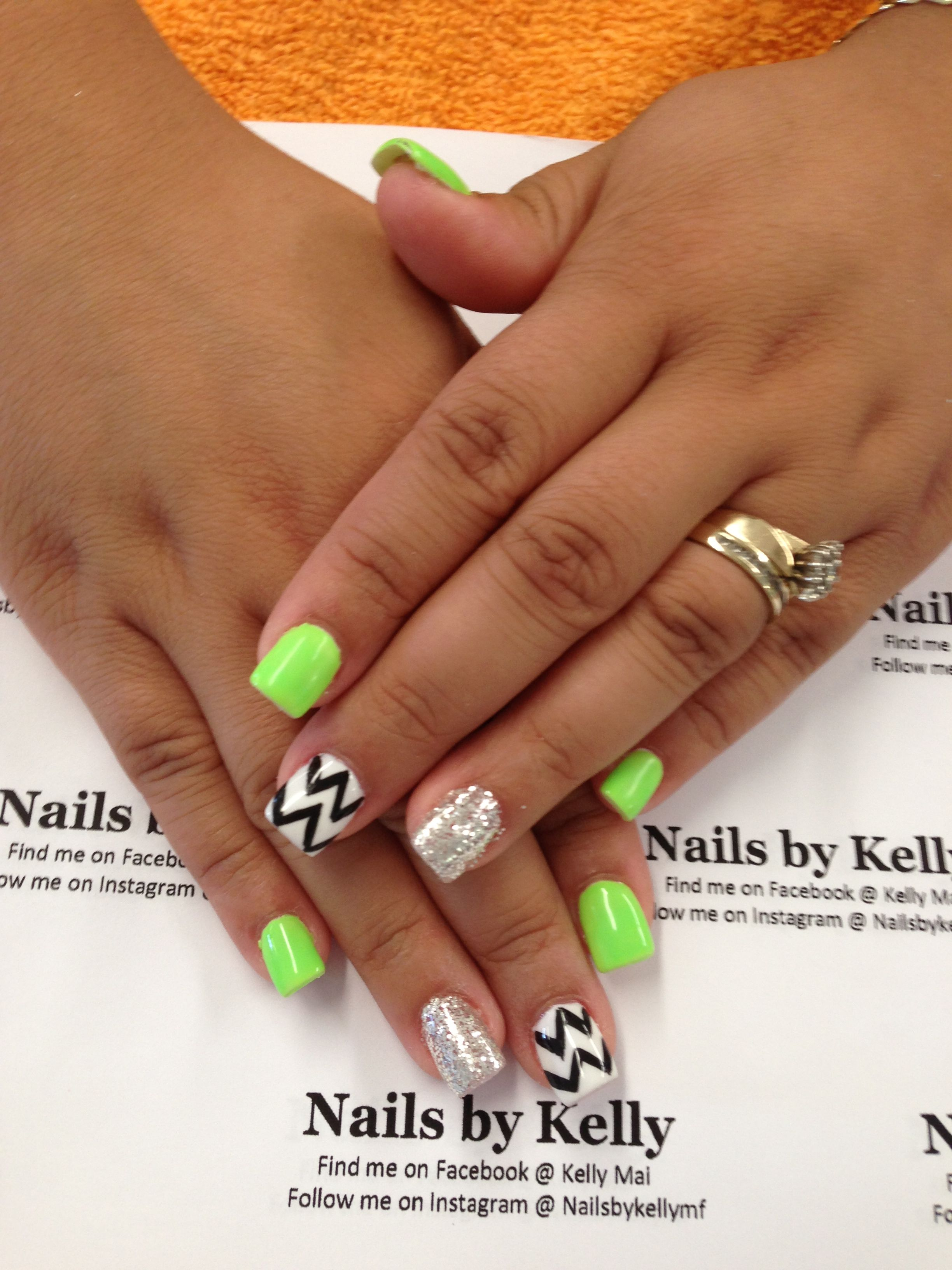 lime green, white, and black with sliver glitter and chevron nail