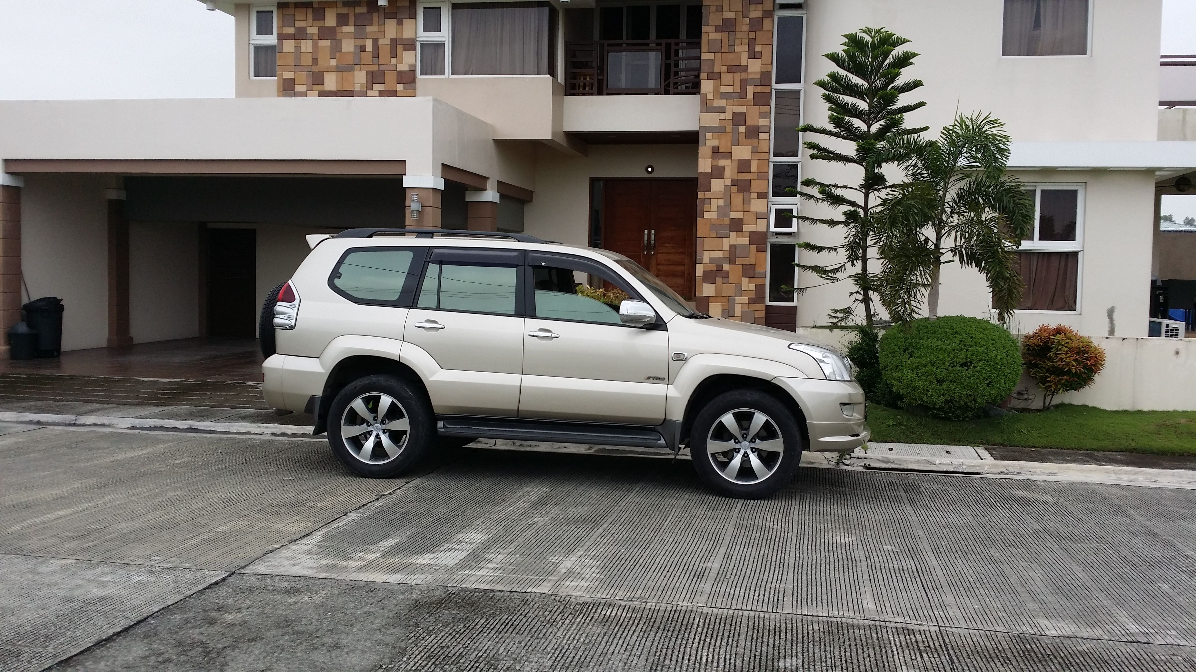 Prado 120 with 20 inch oem toyota rims and customize front spoiler