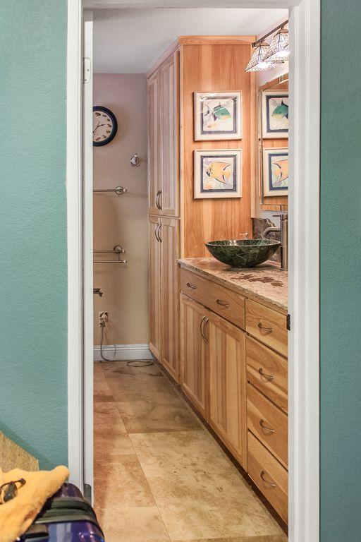 Natural hickory bathroom cabinets create a sleek, modern ...