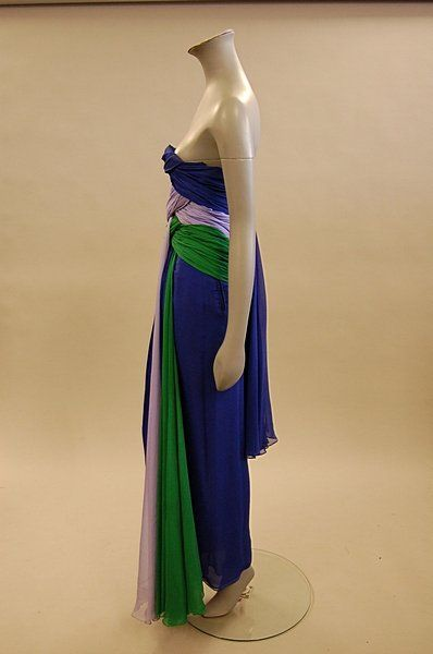 A Jacqueline de Ribes swathed chiffon evening gown, 1980s, labelled, Paris-New York, size 0/S, with tri-colour panels and trailing of blue, lilac and emerald green. Sideway