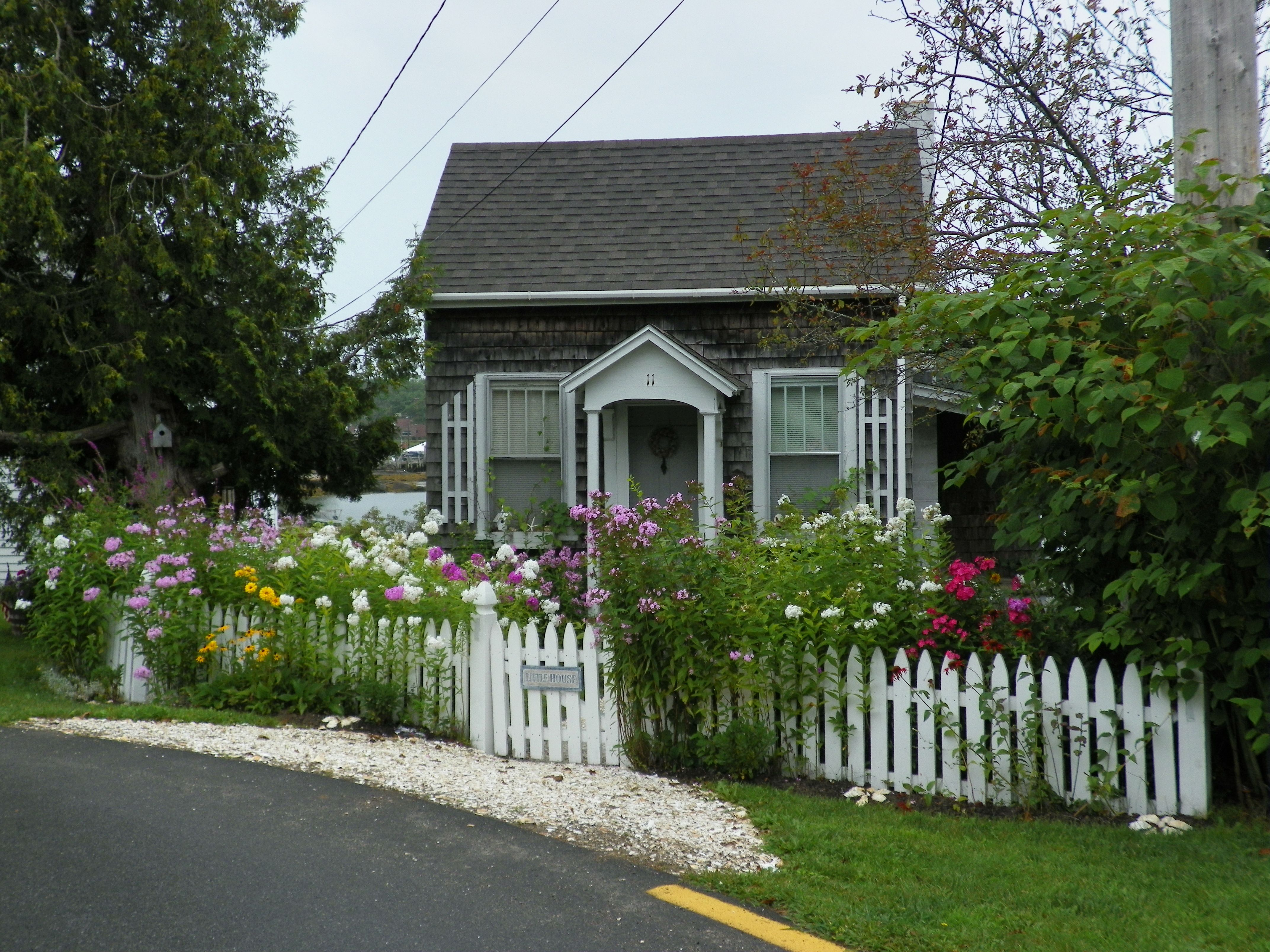 Tiny Little House In Boothbay With Beautiful Flower Gardens Tiny Little Houses Cute Small Houses Small House
