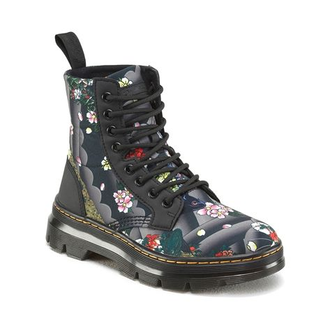 Part of the TRACT Collection, the Dr. Marten Combs Tattoo Boot combines lightweight materials with heavy duty construction in a fold-down boot that suits whatever terrain you travel. The Combs Tattoo Boot features a rubbery synthetic leather that is inset with panels of durable, breathable canvas. The upper is printed with koi fish, flowers and peacocks in a Japanese-influenced tattoo pattern inspired by vintage US Hardcore style. The famous Dr. Marten air-cushioned sole bolsters every step…