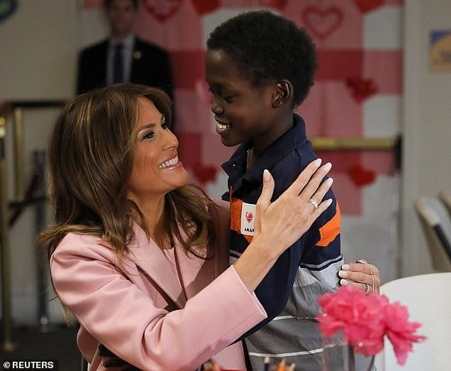 Melania Trump wears pink for Valentine s visit to children s ... d5dbb6947523f