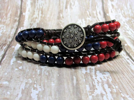 The patriotic leather wrap bracelet uses ivory, red coral and dark lapis Swarovski crystal pearls. The bracelet is woven on a loom using natural antique brown genuine leather cord and KO thread. These leather wrap bracelets are very popular, so get yourself one to celebrate America!  The Americana bracelet wraps three times around your wrist and will fit size 6 to 7 1/2 wrists. It has an antique silver plated metal star button and two button holes for adjustment. The bracelet measures…