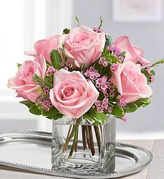 1800Flowers' Mother's Day Sweet Sentiment floral arrangement features a classic selection of pink roses and waxflowers in a glass cube vase! #mothersdayflowers