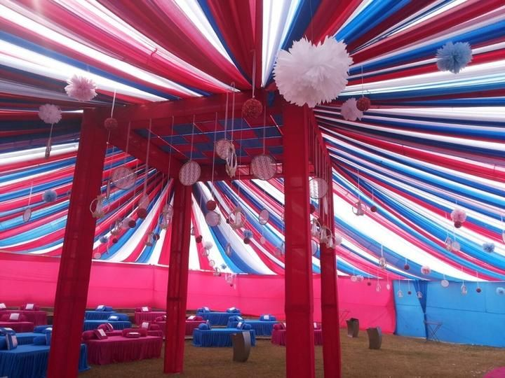 Red blue white draping over tent with hanging roseballs and check images for waamos events explore their work and contact them for prices and availability find this pin and more on indian wedding decor junglespirit Gallery