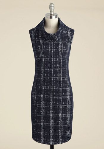 By sporting this sweater dress to your upcoming interview, you're certain that your degree will be put to good use! With its curved hemline and navy-and-dove-grey plaid, this turtleneck sheath dress is a surefire talking point to steer the convo towards your artist prowess.