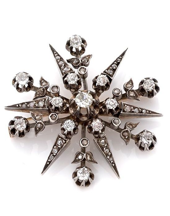 A DIAMOND, SILVER AND 18K GOLD BROOCH, CIRCA 1880. Set with old and rose cut diamonds, in 18k gold, silver, ca. 1880, 4.5 cm, 18.08 g