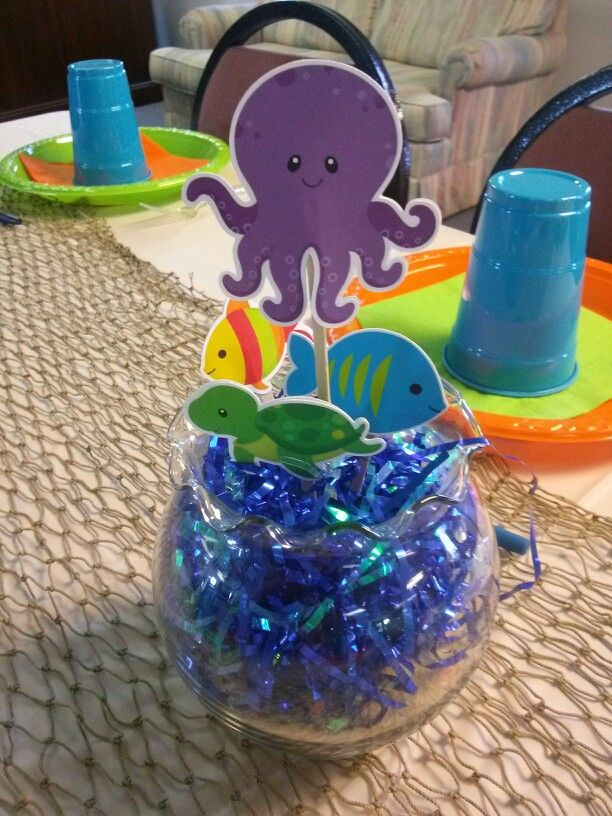 Under The Sea Baby Shower Theme Center Pieces. Sand With Blue Paper On Top.